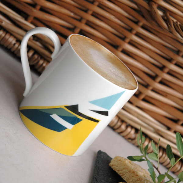 Twenty Birds Blue Tit mug with coffee and biscuits in front of a wicker basket