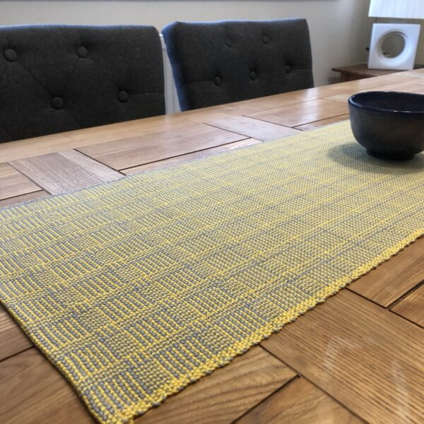 Cotton Table Runner in a sunny yellow and steel grey, the patter called Log Cabin produces an interesting 3D effect.