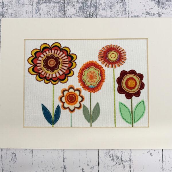 Blue Design Shed Funky Flowers Applique. Appliqued retro flower picture in cardboard mount