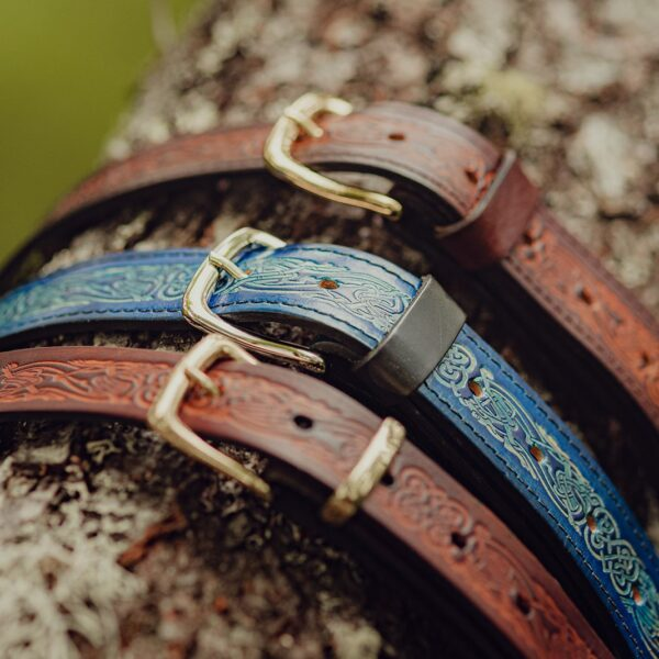 Embossed leather belts in blue and brown