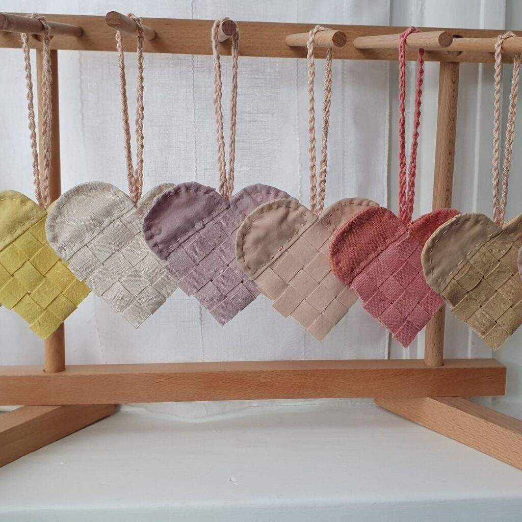 needle in the mill, hand woven hanging hearts, hand dyed with acorns, tumeric, blackberries, onion skins, madder, horse chestnuts and avocados