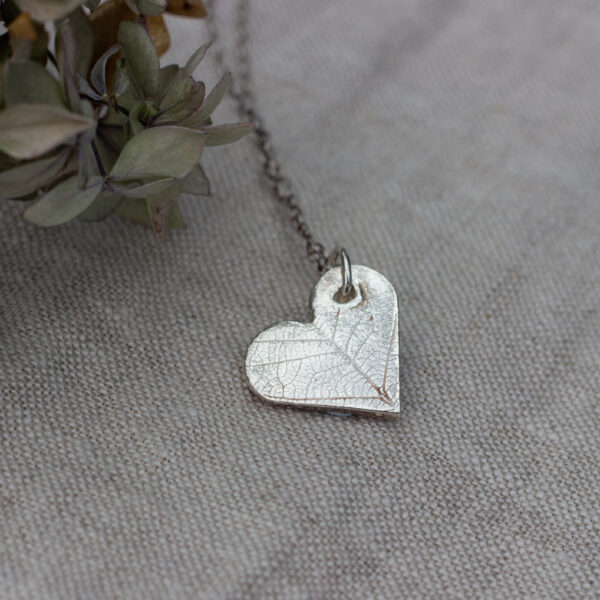 The Little red hen eco silver heart shaped pendant with leaf pattern
