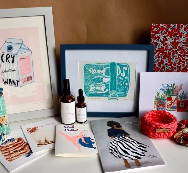 A selection of Brown Paper Festival stallholders products including art, facial oils, candles and greeting cards