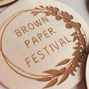 A lasercut wooden version of the Brown Paper Festival logo