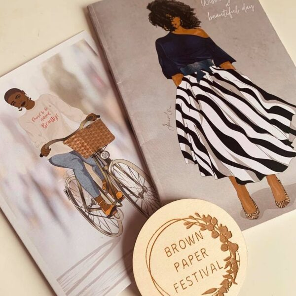 Two prints from Ionna Marie Designs featuring fashionable black ladies in amazing outfits alongside Brown Paper Festival logo
