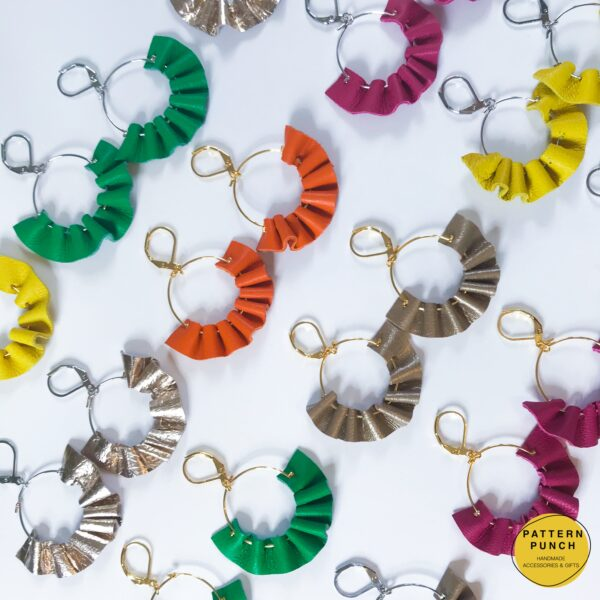 A selection of leather ruffle style earrings in bright colours or neutral metallics. Pattern Punch