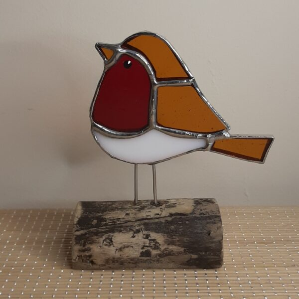 stained glass robin on wood