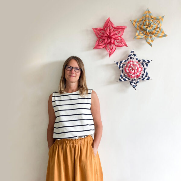 Art Star folded paper star kit founder Jo Hill with colourful paper stars