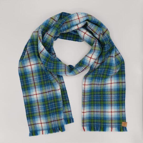 Taffled Threads Snowdrop Tartan Blanket Scarf on a grey background