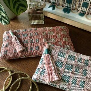 Studio Milena, Handwoven cosmetic bags, slim textile clutch bags, tassel trim, Green and pink, geometric pattern, woven design