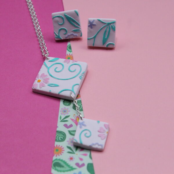 Pink polymer clay hand painted and embossed necklace and earrings. Handmade and unqiue apart of the flourishing florals collection