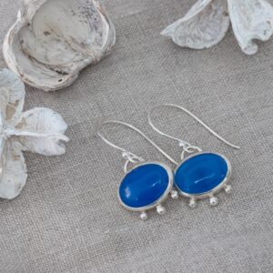 Electric blue agate and silver earrings with little bobbles on a linen cloth. All in sterling silver and handmade by g designs artisan jewellery.