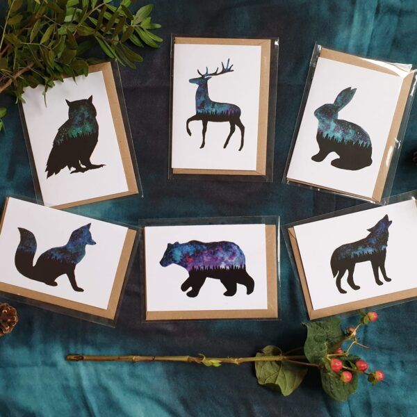 6 galaxy animal themed cards with decorative branches and nature and pinecones. Willow and Moon