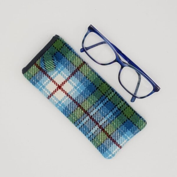 Taffled threads Snowdrop Tartan Glasses case on a grey background