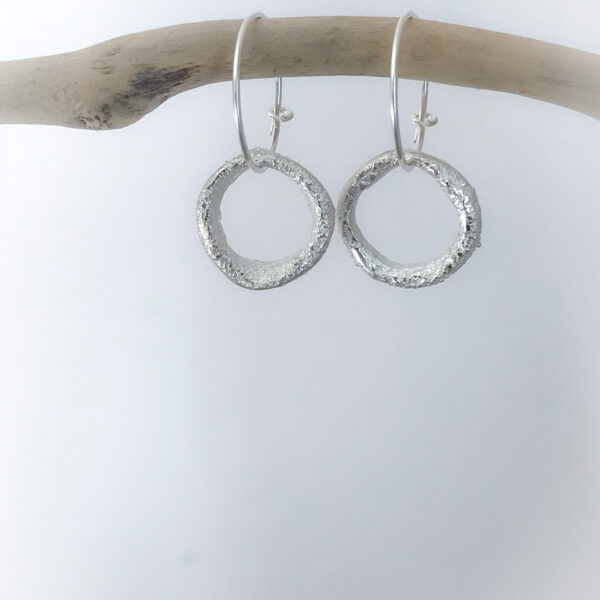 gail ann jewellery,irregular shaped silver hoop earrings with textured surface on a sterling silver hoop fitting