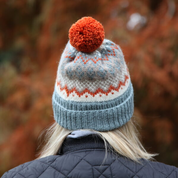 Knit 'Tings fair isle bobble hat in blue, off white, beige and orange, with an orange yarn pom pom