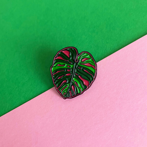 Monstera Leaf Plant Enamel Pin on Pink and Green Background