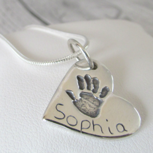 true love keepsakes, heart handprint charm necklace made from pure silver personalised with a name