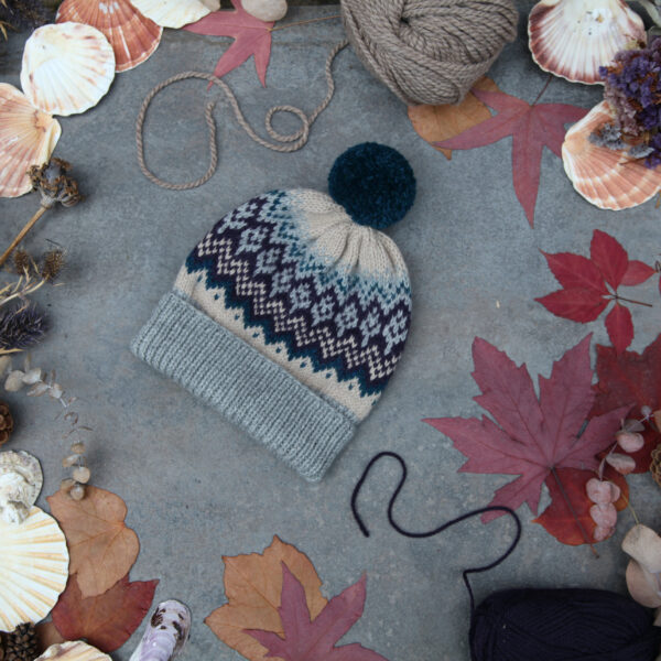Knit 'Tings fair isle bobble hat in grey, petrol blue, beige and purple, with a petrol blue pom pom