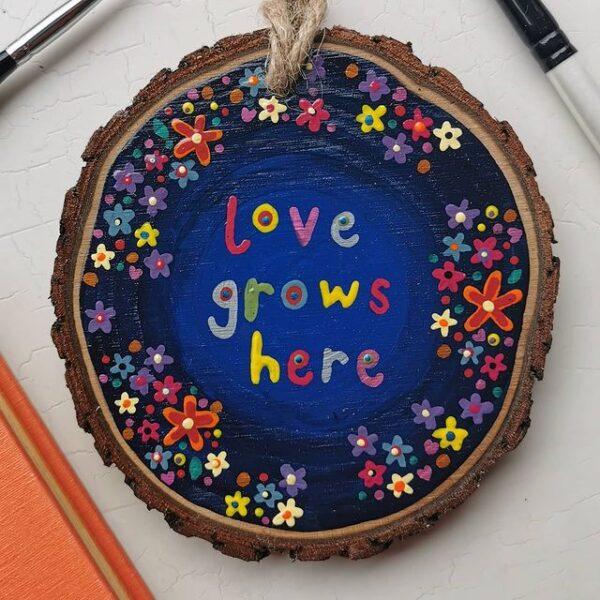 Love Grows Here blue artwork.