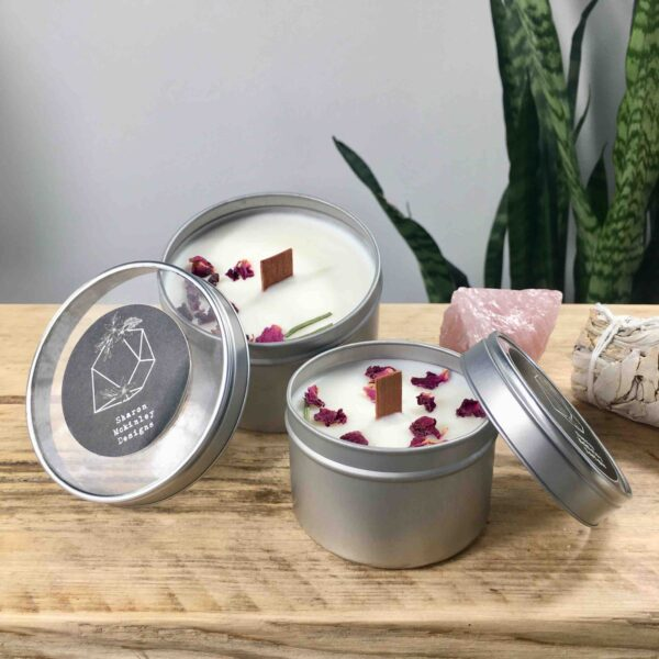 Sharon Mckinley designs, a tin candle made of soy and coconut wax, with rose petals on top,