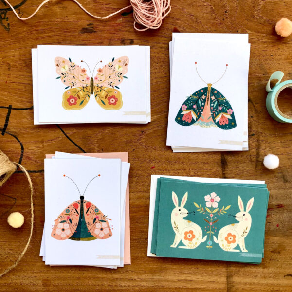 4 A7 size postcards of decorative insects and rabbits illustrated by Bee Brown on a wooden background