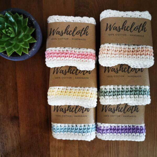 Daisy Makes, cotton washcloths in white with purple trim, blue trim, green trim, yellow trim, peach trim, pink trim