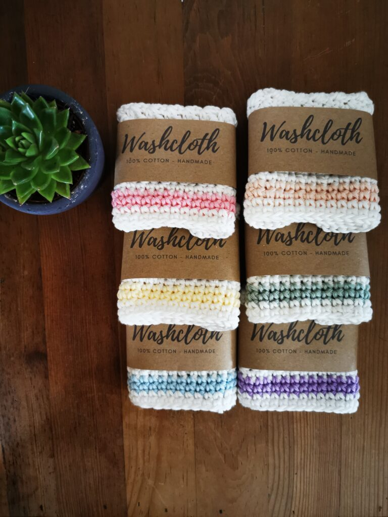 Daisy Makes, cotton washcloths in white with purple trim, blue trim, green trim, yellow trim, peach trim, pink trim