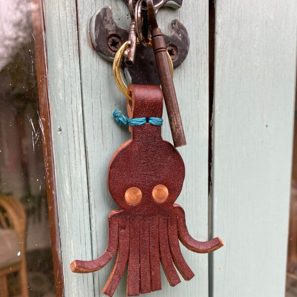 Jen and the beartree, leather octopus keyring in shed door