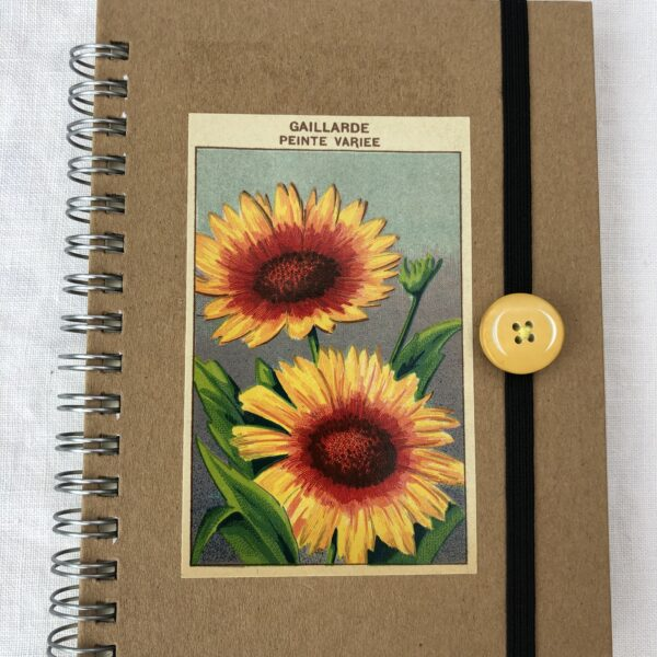 Hat Not Lettuce, A6 notebook embellished with original 1920's French lithograph seed packet label, spiral bound, plain or lined paper; with elastic closure with vintage button