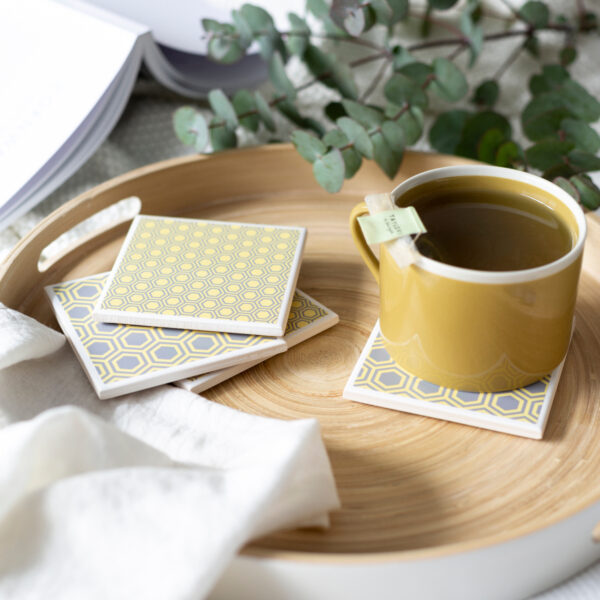 Tile coasters in honeycomb grey and yellow by Yellow Room Designs