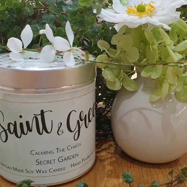 Saint & Green 320ml scented tin candle topped with botanicals and a tin lid