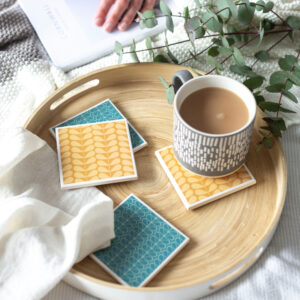 Tile coasters n teal and orange mid century flower design by Yellow Room Designs