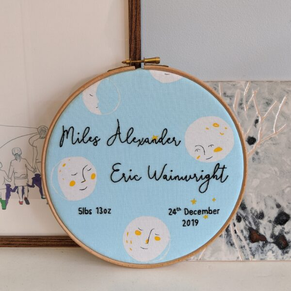 Little Light Stitchery new baby hoop. Moon face fabric with a babies name, weight and birth date hand embroidered