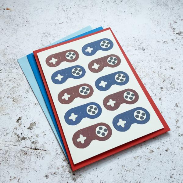 Fussy Geek Wares, SNES red & blue contollers greetings card