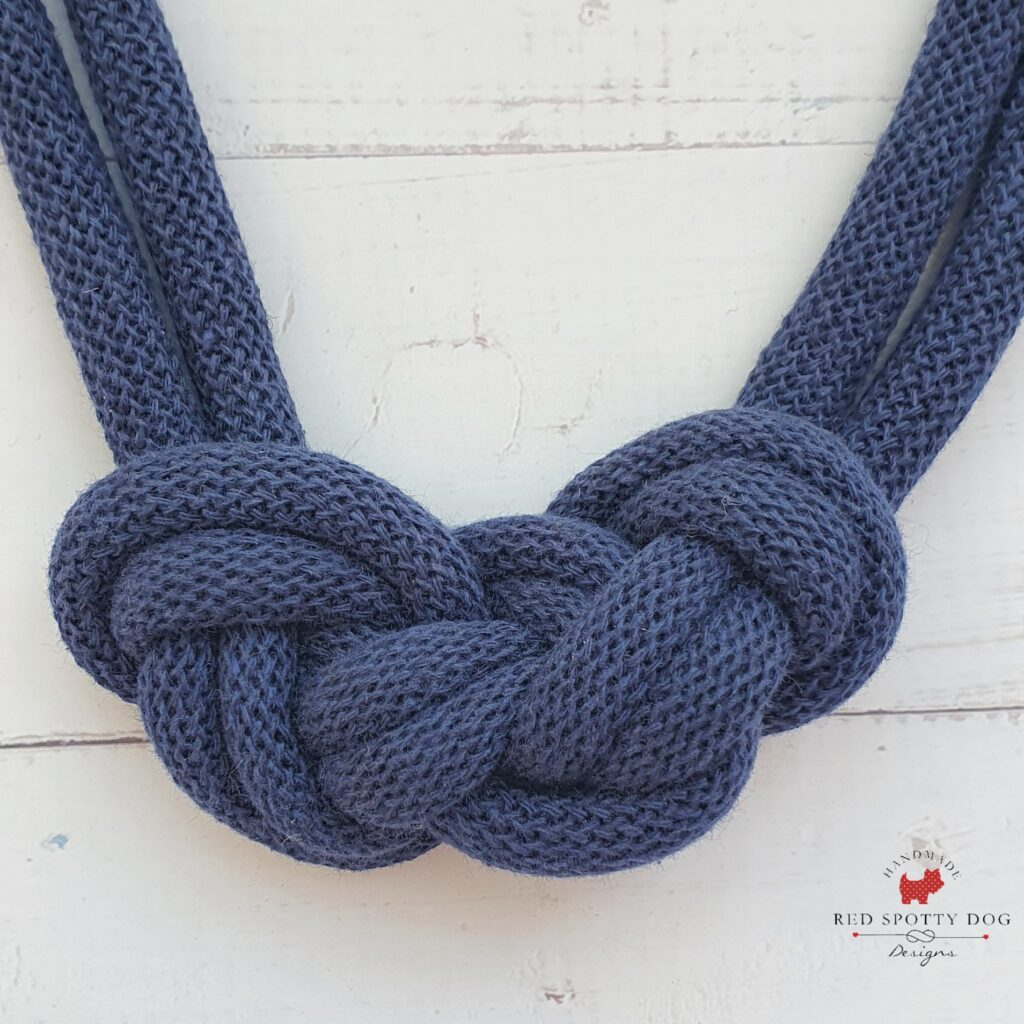 Navy triple knot close up