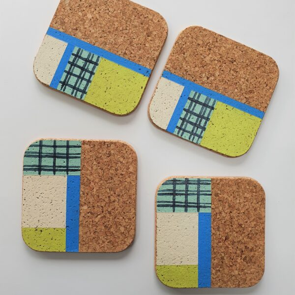 The Present Home A set of 4 square hand painted cork coasters with a geometric design