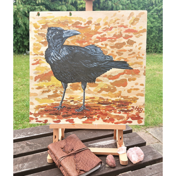 """""""Brandon"""" Crow Painting by Hannah Kate Makes. Original acrylic on board painting showing a black crow against a background of abstract autumn leaves."""