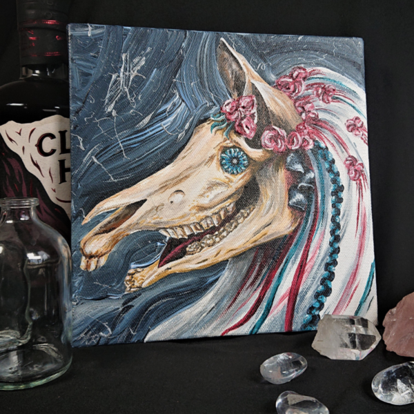 Mari Lwyd Canvas by Hannah Kate Makes. An original acrylic on canvas painting of the Welsh wassailing folk lore creature. A horse's skull adorned with flowers and a glass bottle-bottom eye.