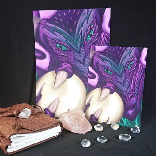 Peregrina Dragon art print by Hannah Kate Makes. A digitally drawn purple dragon with green eyes clutches a giant pearl in her claws.