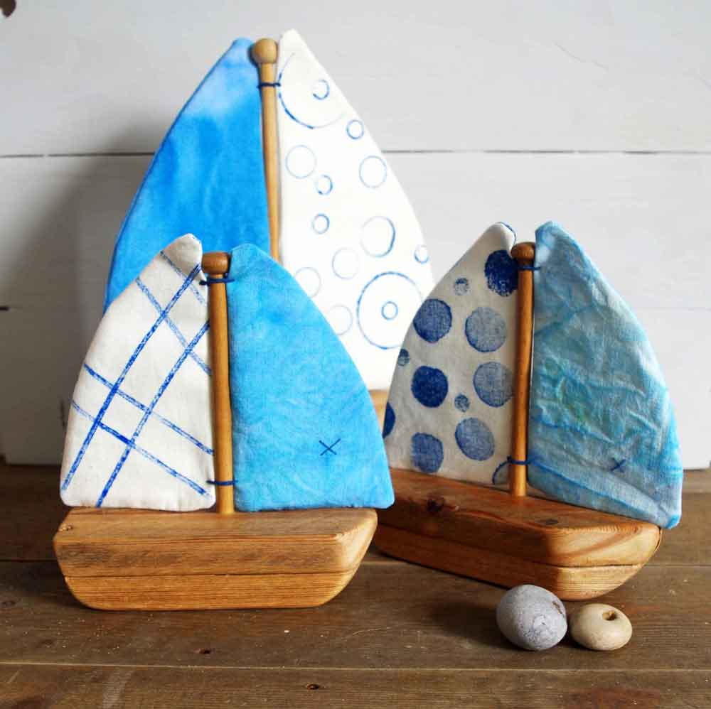 Rachel Fearnley Textile Designs three wooden boats with blue sails