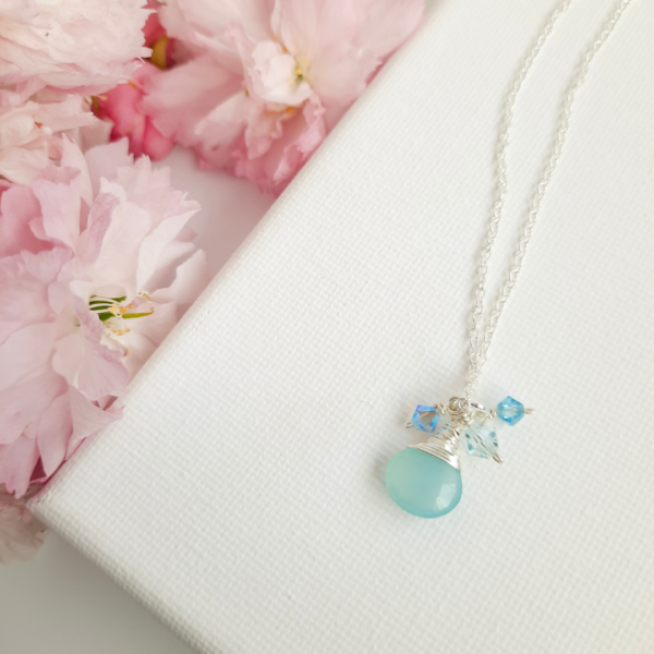 Watermeadow Lane Jewellery, Aqua Blue Cluster is made from sterling silver chain and has a aqua blue gemstone attached with blue crystals attached to create a cluster pendant.