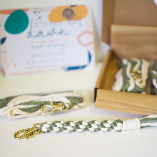 A photograph of a macrame keyring kit in a box.