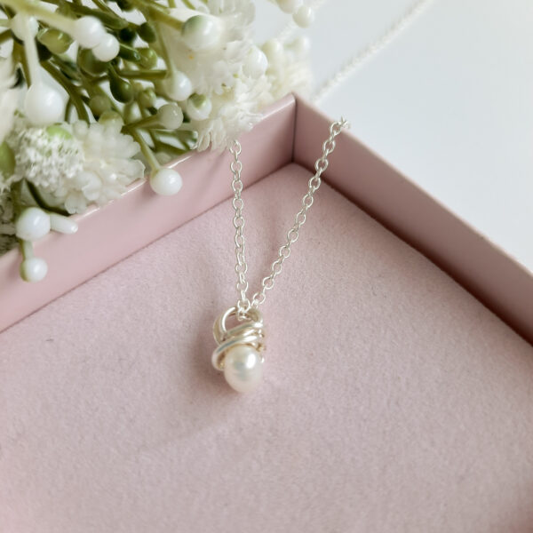 Watermeadow Lane Jewellery Knotted pearl pendant is made from sterling silver and a freshwater pearl has been wrapped to make a special pendant.