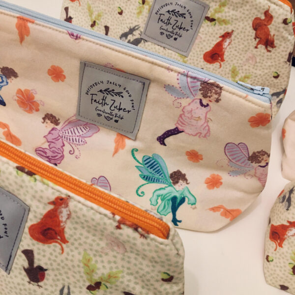 Make up bags depicting fairies and woodland creatures inspired by Hardwick Hall.
