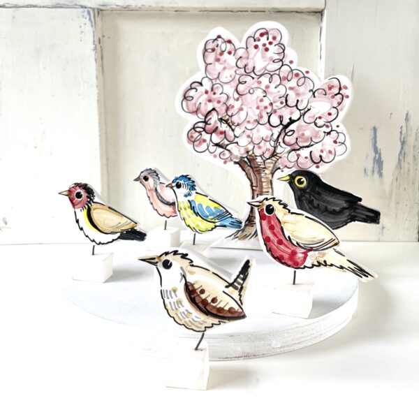 Louise Crookenden-Johnson garden birds, with pink blossom tree pottery ornaments