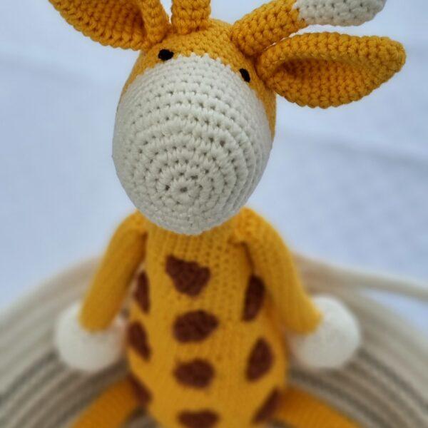 Amaris and Chaya orange and white crochet giraffe toy