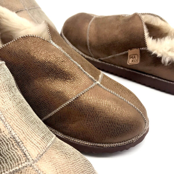 Sheepskin slippers with a textured metallic finish.